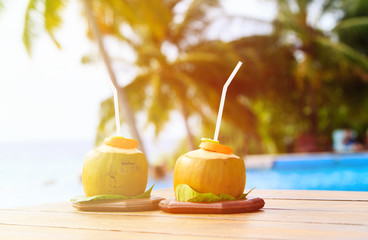 two coconut drinks served in luxury resort