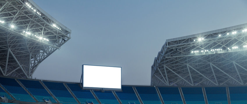Blue seats and electronic billboard display at stadium
