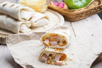 Breakfast burrito with eggs, cheddar, microgreens and roasted mu