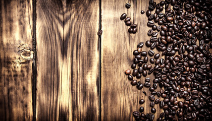 Fresh coffee beans. On wooden background.