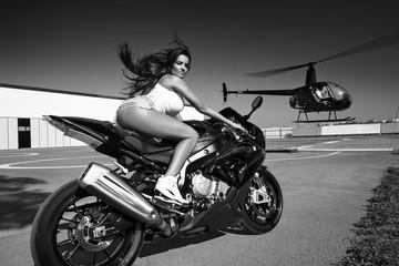 woman riding motorbike on landing ground