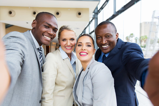 multiracial business team taking selfie together