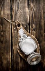 Salt in a glass jar on wooden Board