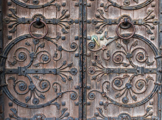 close up detail of old church door design in Cork city Ireland