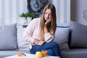 Sad female with hypoglycemia