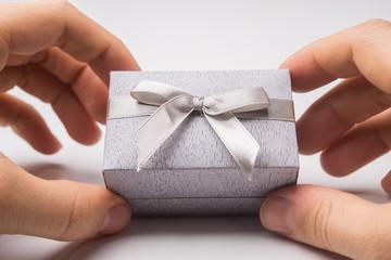 Man holding gift box on white background