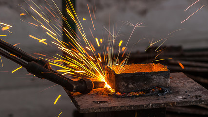 Metal cutting, steel cutting with acetylene torch, industrial wo