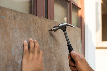 hammer will arrive on nail by man