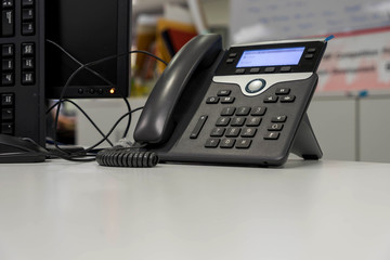 voice over IP Phone on white desk