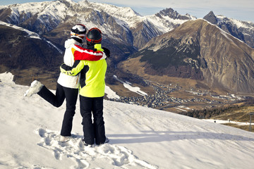 happy couple enjoying winter in mountains