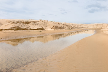 river and dune barrier