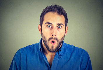 shocked man isolated on gray wall background
