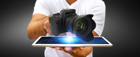 Young man using modern camera