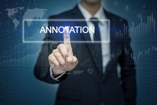 Businessman hand touching ANNOTATION  button on virtual screen