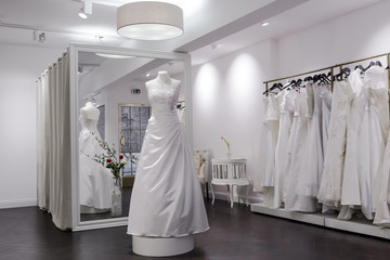 changing rooms at a bridal shop, mannequin and large mirror