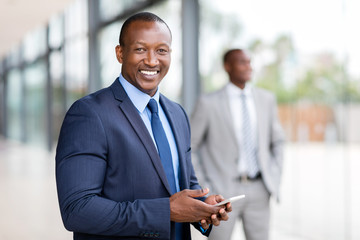 african american businessman using cell phone