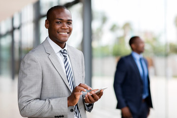 young african businessman reading email on smart phone