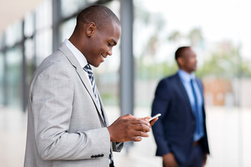 african businessman using smart phone