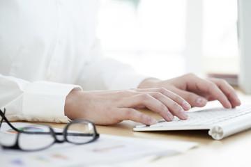 Woman hands on keyboard