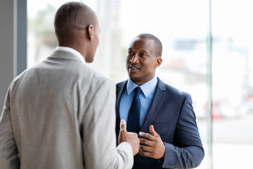 african american businessmen having conversation
