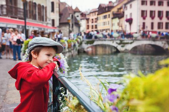 Sweet portrait of preschool boy in the town of Annecy, France, s