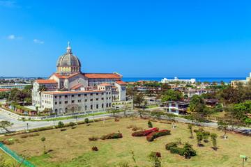 Hotels and Catholic cathedral at coastline of modern Havana