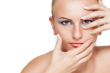 Woman beauty portrait with colorful makeup and manicure