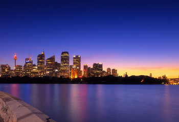 Australia Sydney city CBD view from cremorne point over harbour waters at sunset, taken by long exposure technique