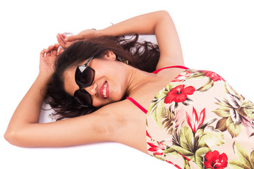 Beautiful women wearing sunglasses, lying on the ground.