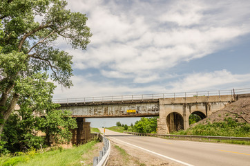 Rusty Railroad Bridge Over Country Road