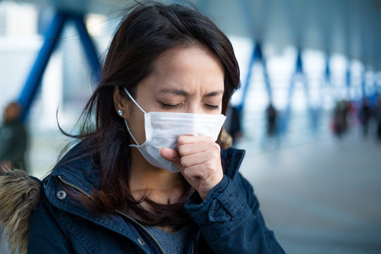 Woman suffer from cough with face mask protection