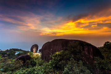 Fotobehang Zwavel geel sunrise at the sacred Kitchakood mountain in Chanthaburi province east of Thailand