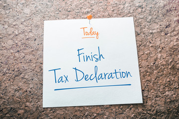 Finish Tax Declaration Reminder For Today On Paper Pinned On Cork Board