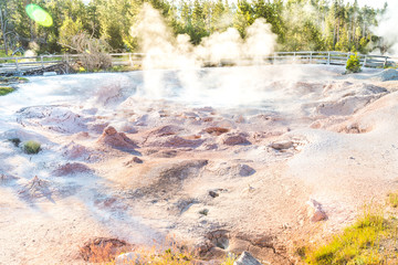 people watching geyser,scenic view of colorful Geysers in the Yellowstone National park,Wyoming.usa.