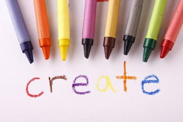 Colorful crayons and the word create
