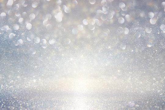glitter vintage lights background. silver, blue and white. defocused.