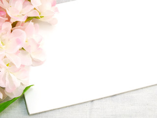 white card and artificial flower space for copy background