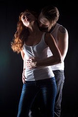 Woman with red hair and hugging man