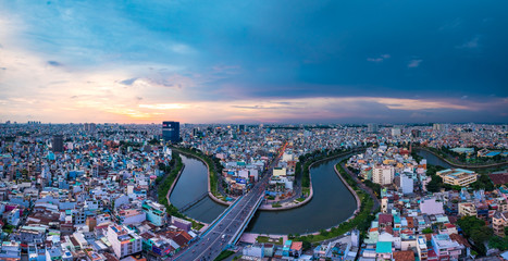 Aerial sunset view of rooftop skyscraper on Nhieu Loc canal in Ho Chi Minh city, Vietnam