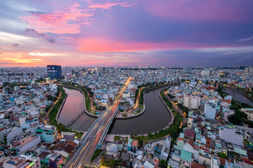 HOCHIMINH CITY, VIETNAM. Aerial sunset view of houses and Business and Administrative Center of Ho Chi Minh (SAIGON) city on NHIEU LOC canal