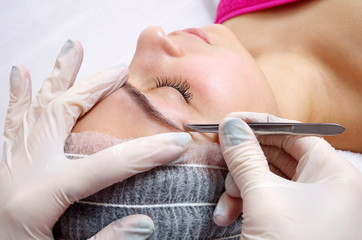 woman doing brow procedure