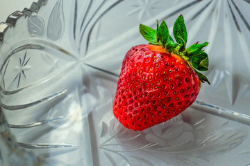 Strawberry in a crystal vase.