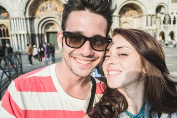 a loving couple take a selfie on Holiday - people,lifestyle and Holiday concept