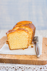 Slice of homemade orange cake on cutting board. Selective focus