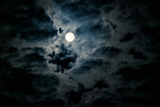Mysterious night sky with full moon. Horror and Halloween concept.