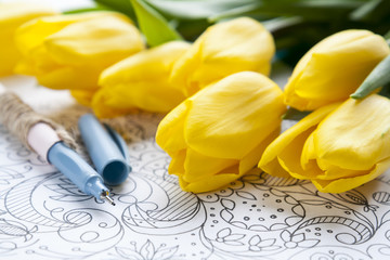 Yellow fresh tulips with graphic sketch and pen