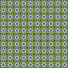 Seamless pattern with white and green stars on blue background