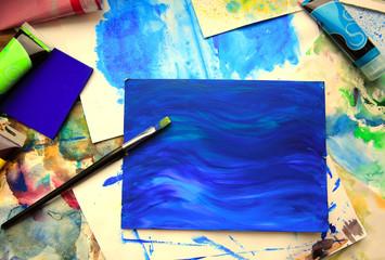 Closeup of brush and art painting