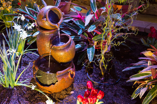 Pottery water fountain at night