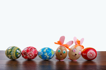 hand painted Easter eggs on the wooden texture